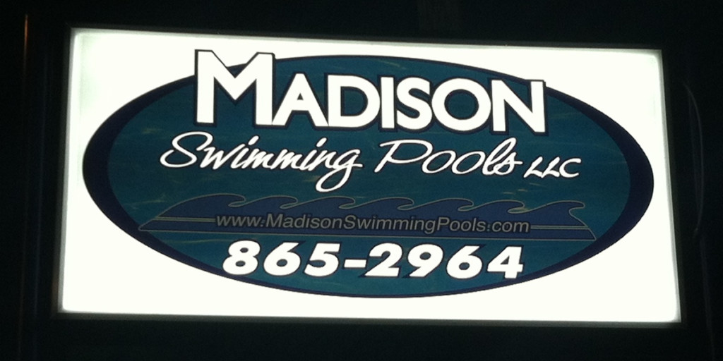 light up sign for madison swimming pools night